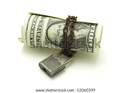 US dollars chained and locked on white background