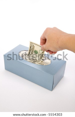 us dollars in a tissue box, business concept, wasting money
