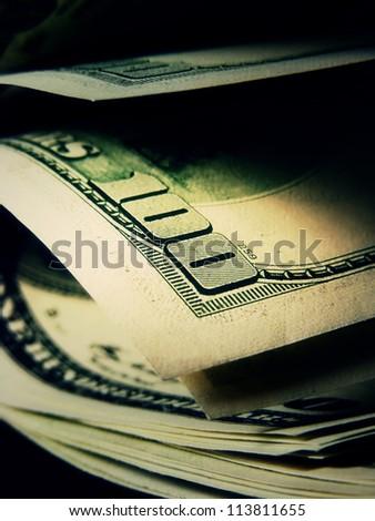 US dollars in dark style. Macro image.