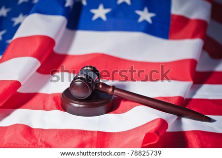 US flag and brown gavel