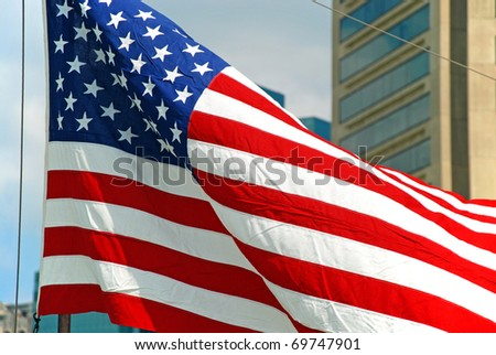 US flag flapping in wind in Baltimore Inner Harbor in Maryland