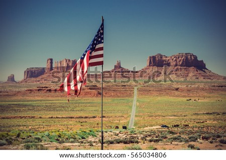 US Flag in front of front of Monument Valley, Utah, USA, Vintage filtered style