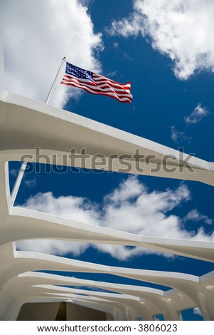 US flag over the  U.S.S. Arizona Memorial in Pearl Harbor, Hawaii