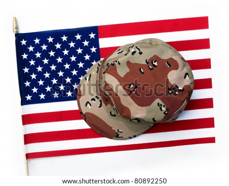 US Flag with Camouflage Cap Combat Hat isolated on white background