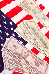 US flag with dollars close up