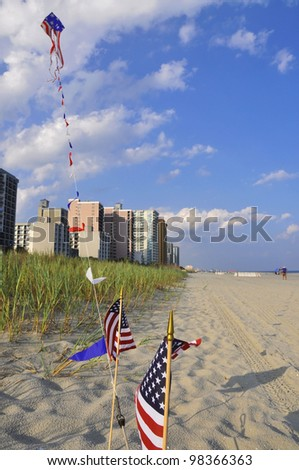 US Flags and kite at the beach