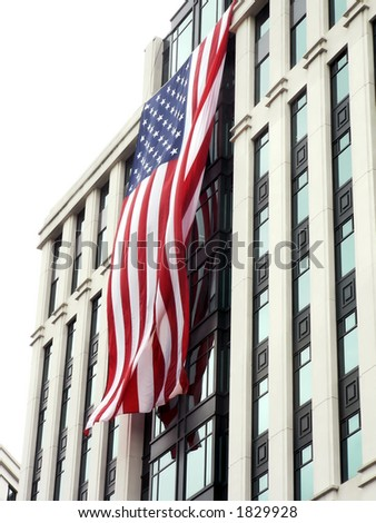 US flags, during a cloudy day, hung on front of bldgs. in Arl., VA as a 9-11 memorial.