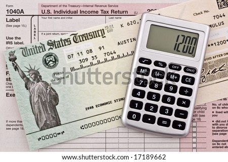 US government stimulus refund check with calculator and tax form 1040a. Numbers have been altered and name removed.