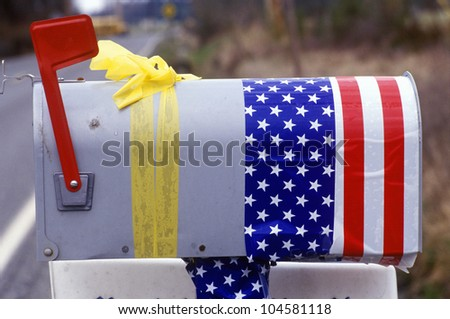 US Mailbox with yellow ribbon and American Flag as decoration