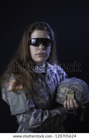 Us military woman with helmet and tactical glasses