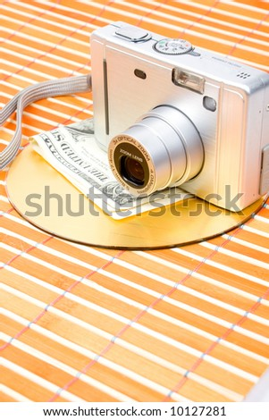 Us money and digital photo camera with dvd disk