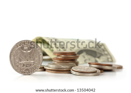 US money - coins and dollar bill, isolated on white.  Shallow depth of field, soft focus.