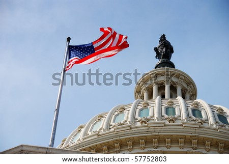 US national flag flying over Capitol Hill Building in Washington DC