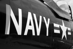 US Navy markings on the side of a restored vintage aircraft.