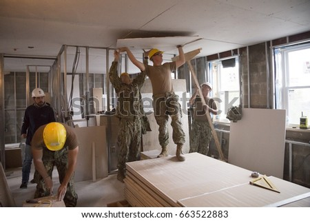 US Navy Seabees help Habitat for Humanity NYC on a housing building project in Brooklyn during Fleet Week New York, celebrating Sea Services and 75th anniversary of the Seabees, NEW YORK MAY 25 2017.