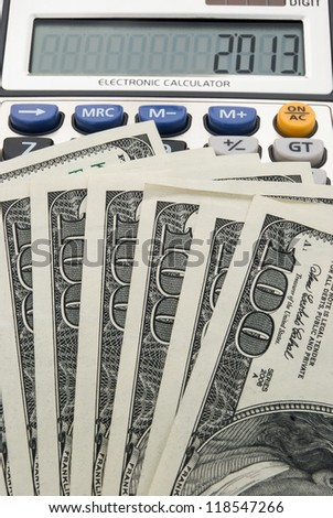us paper currency and calculator shows 2013