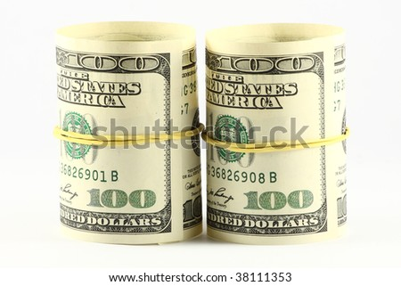 US paper currency bills rolled up and tied with a yellow rubber band. Empty inside.