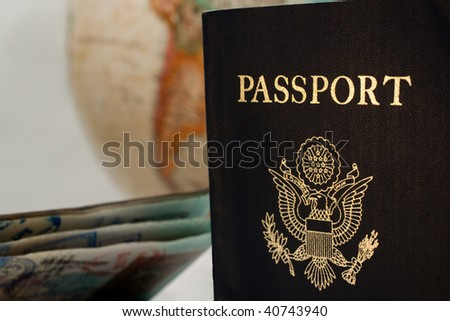 US Passport with south American continent visible on the globe behind - stock photo
