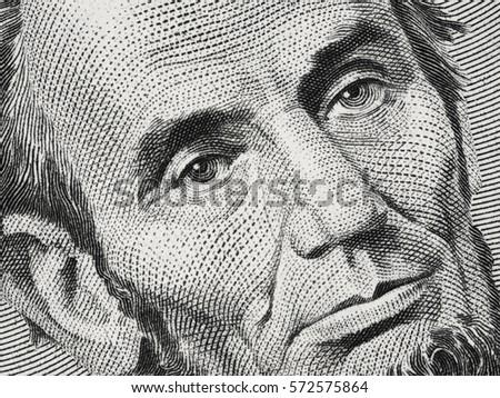 US President Abraham Abe Lincoln on USA five dollar bill extreme macro, 5 usd, United States of America money closeup