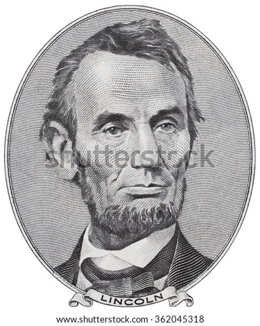 US President Abraham Lincoln on five dollar bill macro isolated, 5 usd, united states money closeup