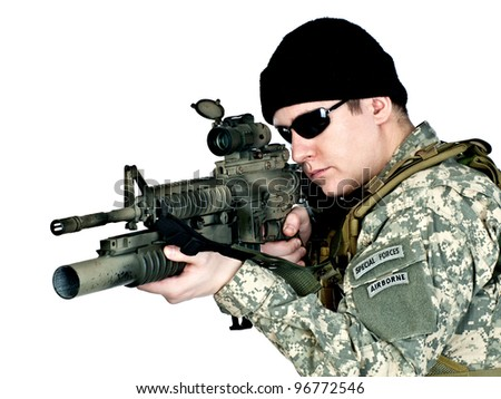 US soldier aiming with his assault rifle