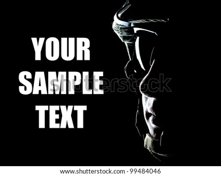 US soldier on the black background with the lot of copyspace