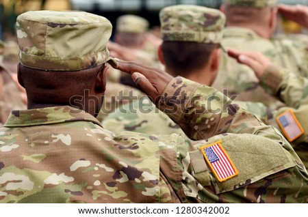 Photo of  US soldier salute. US army. US troops. Military of USA.