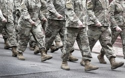 US soldiers. US army. Military forces of the United States of America.   Soldiers marching on the parade. Veterans Day. Memorial Day.