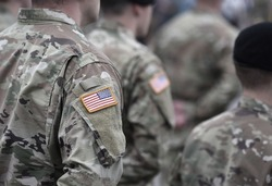 US soldiers. US army. USA patch flag on the US military uniform. Soldiers on the parade ground. Veterans Day. Memorial Day.