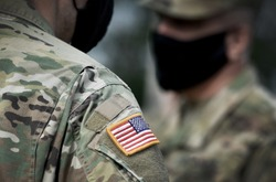 US soldiers wearing protective face masks. Quarantine in army.