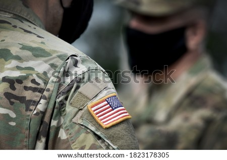 Photo of  US soldiers wearing protective face masks. Quarantine in army.