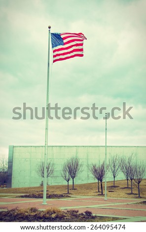 US United States Flag handing proudly over the the Liberty State Park 9/11 Memorial in New Jersey - vintage retro look