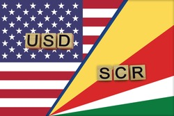 USA and Seychelles currencies codes on national flags background. International money transfer concept