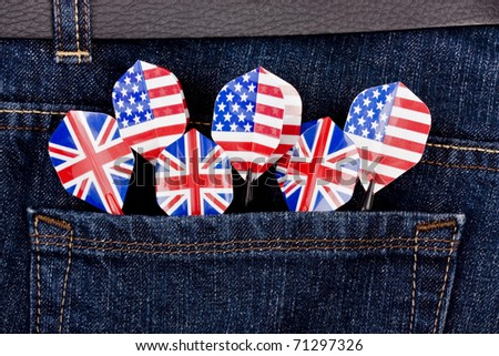 USA and UK darts in jeans pocket