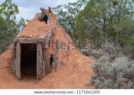 USA, Arizona, Navajo Nation, Navajo National Monument. A hogan is a hut house constructed with a central support of forked logs covered in mud. It is the traditional dwelling of the Navajo.