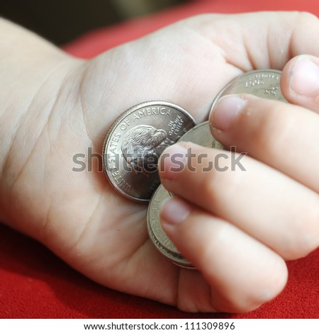 USA cents in child arm