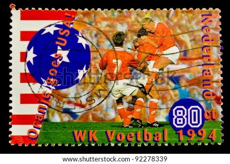 USA - CIRCA 1994: A post stamp printed in USA shows football player, devoted football world championship,USA, circa 1994.
