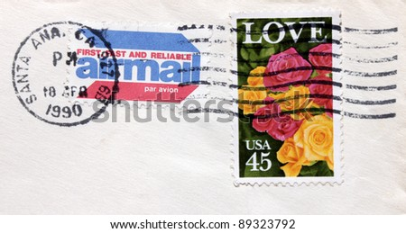 USA - CIRCA 1990. A postage 45c stamp printed in USA shows image photo of beautiful roses. Postmark from Santa Ana California on a postage envelope (dated 1990). circa 1990