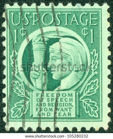 USA - CIRCA 1941: A stamp printed in the USA shows Liberty and words Freedom of speech and religion, from want and fear, circa 1941