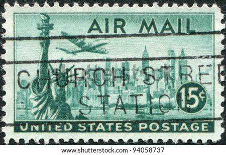 USA - CIRCA 1947: A stamp printed in the USA, shows the Statue of Liberty and New York Skyline, airliner Lockheed Constellation, circa 1947