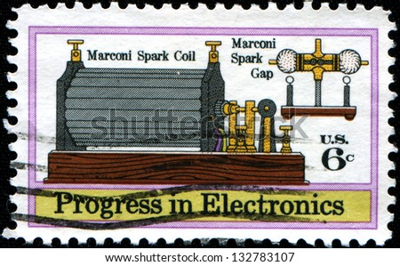 "USA - CIRCA 1973: A stamp printed in United States of America shows shows Marconi's Spark Coil and Gap (1901), ""Progress in Electronics"" issue, circa 1973"