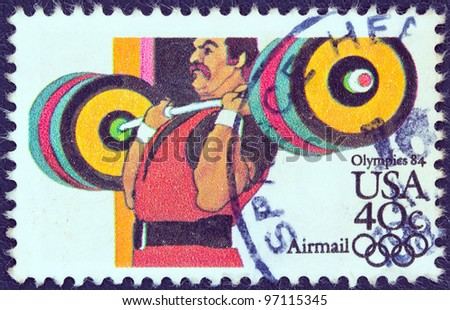 "USA - CIRCA 1983: A stamp printed in USA from the ""Summer Olympic Games, Los Angeles 1984"" issue shows a weightlifter athlete, circa 1983."