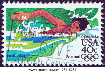 """USA - CIRCA 1983: A stamp printed in USA from the """"Summer Olympic Games, Los Angeles 1984"""" issue shows a swimming athlete, circa 1983."""