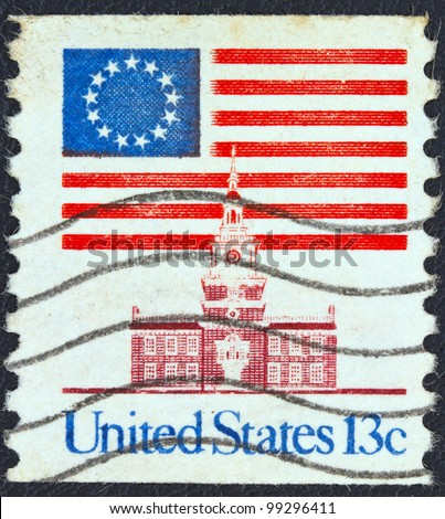USA - CIRCA 1975: A stamp printed in USA showing 13 star flag over Independence Hall, circa 1975.