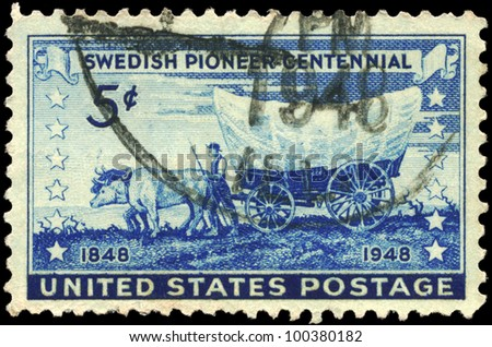 USA - CIRCA 1948: A stamp printed in USA shows the Pioneer with Covered Wagon moving Westward, Swedish Pioneer Issue, circa 1948