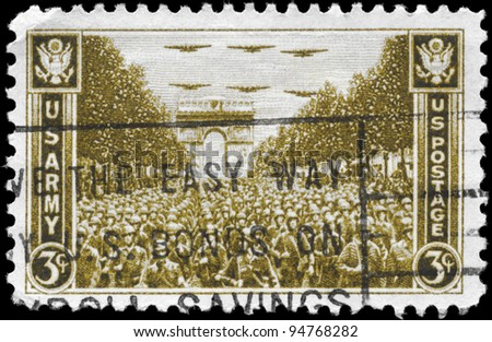 USA - CIRCA 1945: A Stamp printed in USA shows the US Troops Passing Arch Triumph, Paris, circa 1945