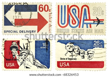 USA - CIRCA 1973: A stamps printed in USA showing 18, 20, 26, 60c series, identifying Mount Rushmore as a 'Shrine of Democracy', 'Statue of Liberty' and Stamps with USA Air Mail Special delivery.