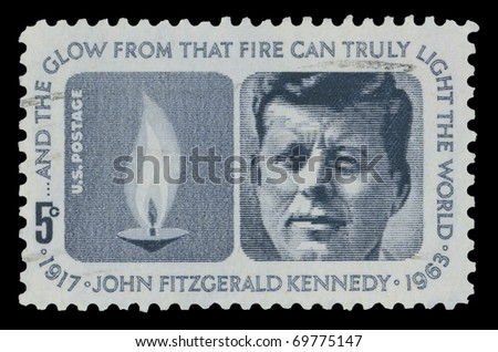USA - CIRCA 1964 - John Fitzgerald Kennedy (1917-1963) American stamp shows the 35th United States President and the Eternal Flame, circa 1964.