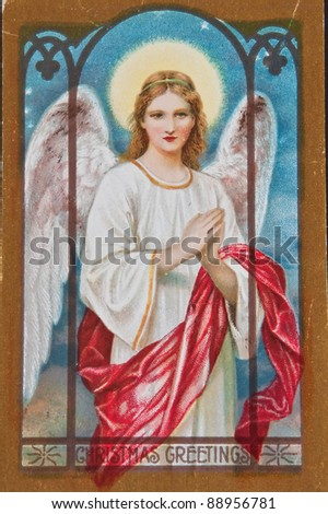 USA - CIRCA 1900 - This aged vintage postcard is showing signs of wear, in a Christmas holiday angel with words Christmas Greetings, circa 1900