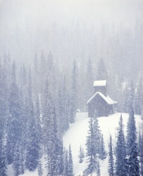 USA, Colorado, Abandoned Silver mine in Snow Storm
